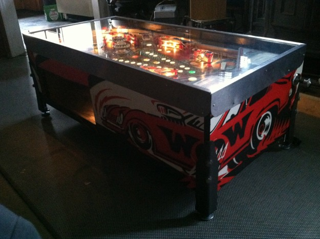 "Bally Ground Shaker pinball main console redesigned into a coffee table with magazine storage. 44""L x 22 1/2"" W x 17"" H"