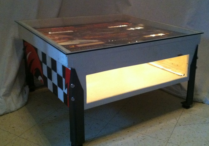 "Bally Ground Shaker pinball scoreboard console redesigned into a coffee table with magazine storage. 31""L x 28 1/2""W x 17"" H"