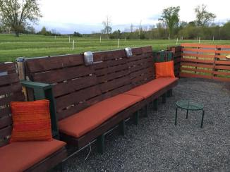 Pallet seating finished with stain, custom cushions, new retro spealers that are wired for sound. (Click on pic to take you to the Drive-in)